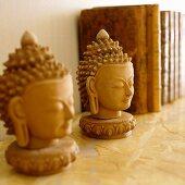 Plaster Buddha's heads on shelf