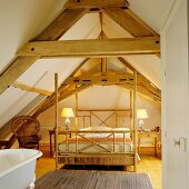Four-poster bed with bamboo frame below open roof structure