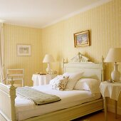 Light, traditional bedroom with yellow and white striped wallpaper
