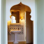 Doorway with Oriental pointed arch and view of vintage-style washstand