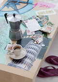 Espresso break on table with photos of urban landmarks under glass top