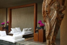 Spa swing bed with cushions in modern Indian atmosphere