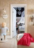 Objets d'art in anteroom with open door showing view of bedroom beyond