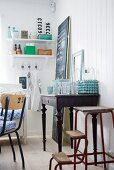 Vintage step ladder next to old writing desk used as sideboard in dining room