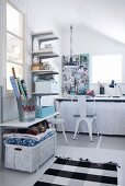 Practical shelving and baskets keeping shabby-chic workroom tidy