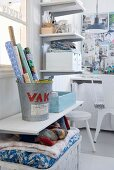 Practical shelving and baskets keeping white, shabby-chic workroom tidy