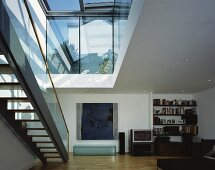 Stairs under ceiling cutout in modern living space