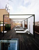 Modern terrace with terrace furniture, sunshades and entrance through sliding, glass roof hatch