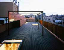 Terrace at dusk with illuminated roof hatch