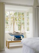 Impressive model sailing boat in bay window of white bedroom