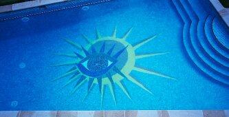Stylised sun-and-eye motif on bottom of swimming pool