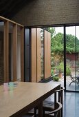 Living space with dining area & view of terrace, garden & extension