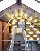 Metal steps beneath roof in contemporary house