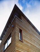 View from below of modern house with wooden facade
