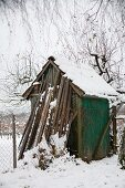 Shed in snowy garden