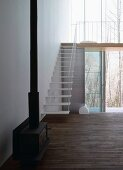 Wood-burning stove next to staircase leading to gallery