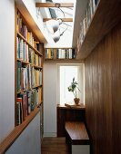 Narrow anteroom with fitted bookshelves