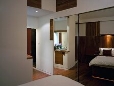Fitted bedroom wardrobe with mirrored, sliding doors