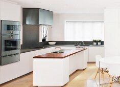 Free-standing kitchen island in designer kitchen