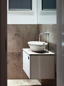 View of bathroom with water running into designer washbasin