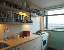 Kitchen with open shelving and window