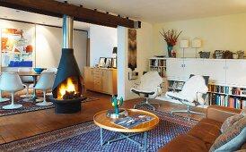 Fireplace in wide doorway between living room and dining room
