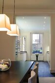 Old London building with view into modern fitted kitchen from dining area