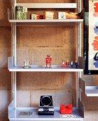 Decorative elements and Playmobil figures on an aluminium shelf