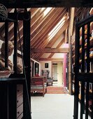 Old barn converted into apartment with historic, wooden-slatted doors