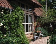Old, English country house with well-established garden