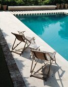 Sunbathing by the pool - wooden deckchairs with folding side tables