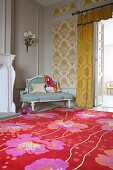 Bright, floral rug in front of Rococo bench