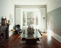 Modern dining table with cantilever chairs in front of sash window