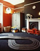 Toy racetrack on black carpet and coloured walls in child's bedroom