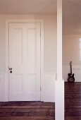 Anteroom with partition on dark, old floorboards