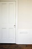 White-painted, panelled interior door