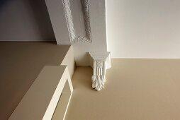 Antique Greek-style bracket below ceiling