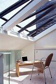 Modern home office below slanting glass roof