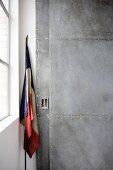Sliding door in riveted metal