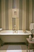 Bathtub against striped wall
