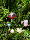 Decorative mushrooms amongst ferns
