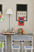 Grey-stained children's desks with stools