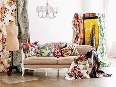 Various patterns on fabric cushions and loose cloth draped on antique sofa