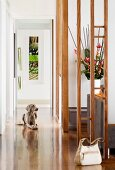 Handbag and gun dog in elegant hallway