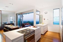Kitchen island with gas cooker in open-plan interior