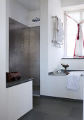 Contemporary designer bathroom with metallic mosaic tiles in shower area