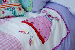 Various children's motifs on patchwork quilt