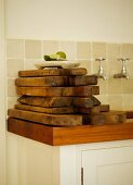 Wooden chopping boards stacked on kitchen work surface