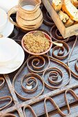 Close up of a rustic coffee tray with decorative metal lattice on a garden table