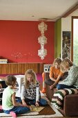Children playing on rug and sofa in living room